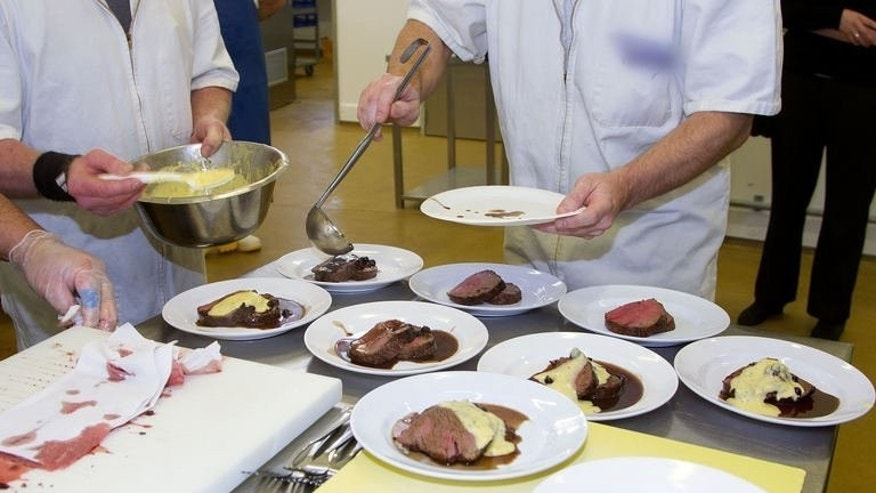 """Rimutaka Prison inmates put together """"Savannah Grass-fed Beef Fillet"""" for the Wellington on a Plate festival on July 30, 2013. The prisoners were nervous about the reception their food would receive when AFP spoke to them just before the banquet on August 9 and 10."""