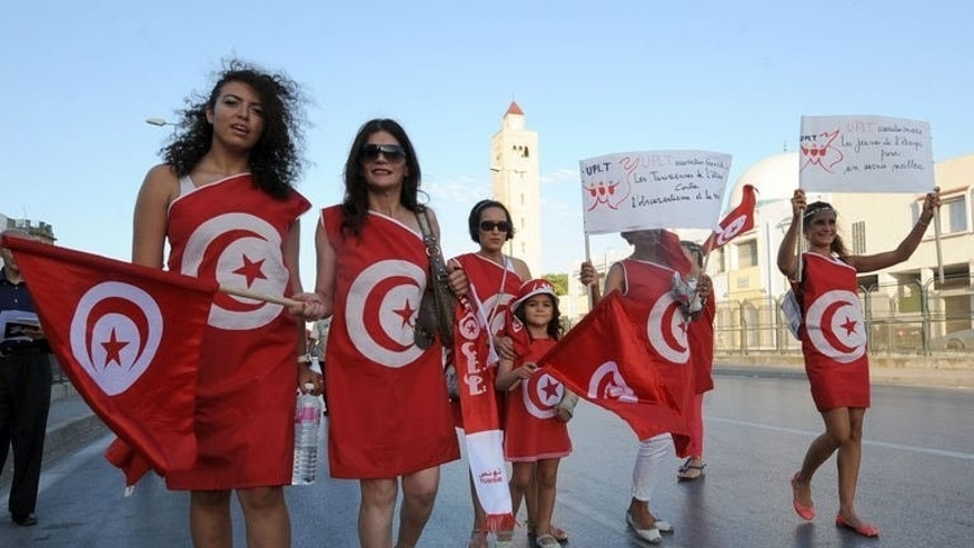 Tunisian demonstrators protest against the Islamist-led government in Tunis on August 13, 2013. Tunisia's political crisis showed no sign of being resolved on Thursday, amid warnings against a slide into the carnage that has swept fellow Arab Spring country Egypt since democratic polls.
