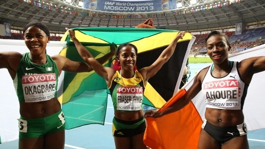 L-R: Nigeria's Blessing Okagbare, Jamaica's Shelly-Ann Fraser-Pryce and Ivory Coast's Murielle Ahoure pose after the women's 200 metres final at the 2013 IAAF World Championships at the Luzhniki stadium in Moscow on August 16, 2013. Women's sprinting has entered a new era, declared African duo Ahoure and Okagbare after they won the continent's first ever medals in a women's world 200 metres final.