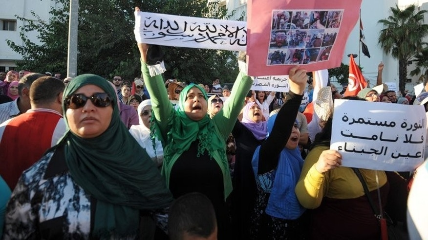 A pro-Morsi rally at the Egyptian embassy in Tunis on Wednesday. Most Arab leaders tacitly support Egypt's deadly crackdown on the Muslim Brotherhood, fearing the group's growing regional influence since the Arab Spring threatens their own power, analysts say.