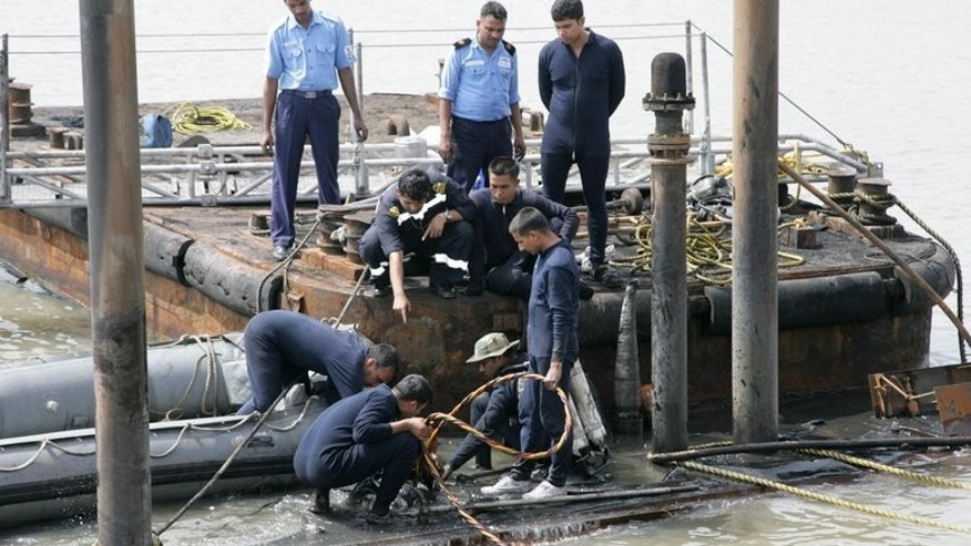 Indian Navy divers and personnel are pictured on August 14, 2013, examining the INS Sindhurakshak. Officials said Friday there were unlikely to be any surviving crew on board.