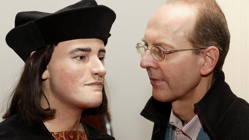 Michael Ibsen, (R) a descendant of England's King Richard III, poses for pictures with a plastic model made from the recently discovered skull of the king, in London, on February 5, 2013. The British public should be consulted on the final resting place of the 15th-century king whose skeleton was found under a car park, a judge ruled on Friday.