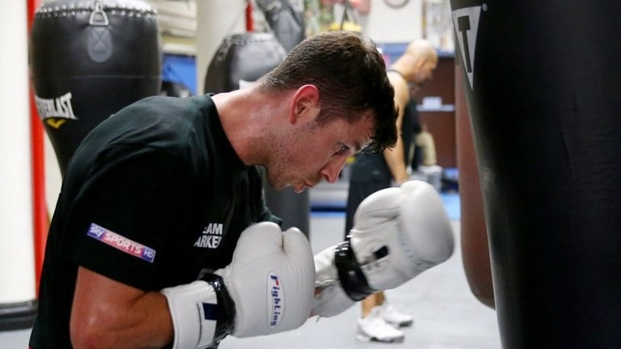 Darren Barker of England trains for his middleweight bout against Daniel Geale of Australia on August 12, 2013. Barker says he wants to win the title and dedicate it to the meory of his brother Gary who was killed in a car accident.