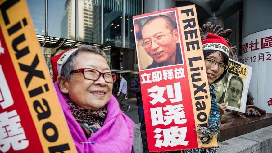 Supporters of Liu Xiaobo stage a protest in Hong Kong last December. Liu Hui's brother, Liu Tong, said he refused to believe government promises that his family was not being targeted because of Liu Xiaobo's political activism, which earned the dissident a Nobel Peace Prize in 2010.