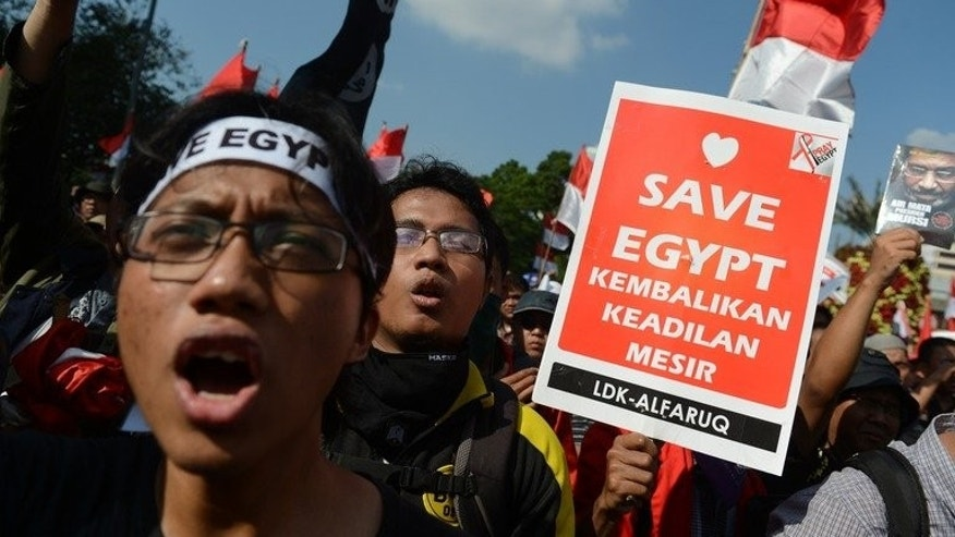 Indonesian Muslims rally outside the US embassy in Jakarta on Friday. Hundreds of Muslims demonstrated in Indonesia and Malaysia Friday against a crackdown on the protest camps of Egypt's Islamists which left almost 600 people dead.