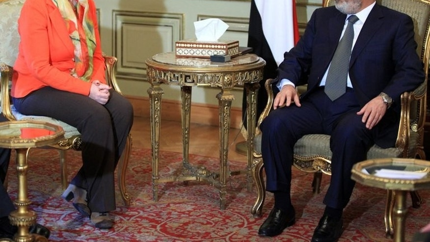 EU foreign policy chief Catherine Ashton meets Mohamed Morsi in Cairo in April. The European Union has said top officials from its 28 members will meet Monday to review the crisis in Egypt, where a military crackdown has left hundreds dead.