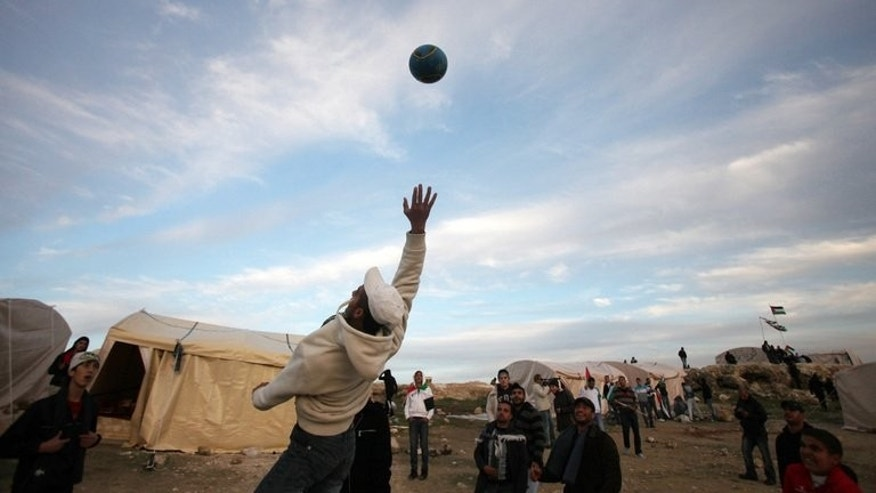 Palestinians play football in the Israeli-occupied West Bank, on January 12, 2013. Israel has bowed to pressure from UEFA to allow Arab youth football teams into the Palestinian territories, having initially denied them entry, a Jordanian official said on Friday.