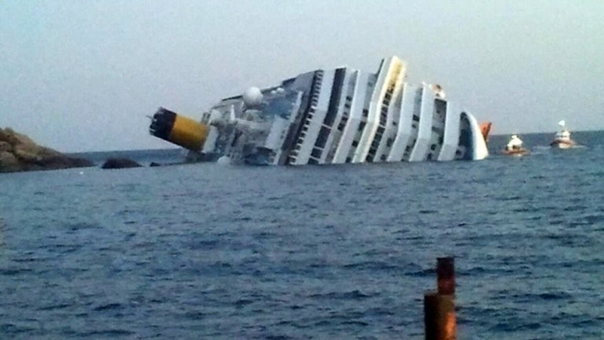 The Copsta Concordia lies on its side off the Isola del Giglio in January last year. The Costa Concordia cruise ship will be raised up next month near the Italian island where it still lies keeled over more than a year on from the deadly disaster, the salvage coordinator said on Friday.