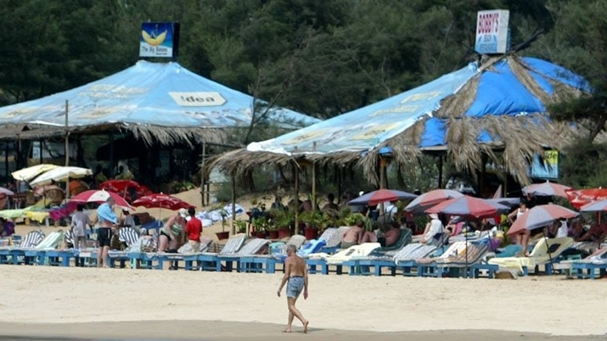 A tourist walks past a row of sunbeds on Baga Beach in Goa in March 2008. India's popular holiday state of Goa has announced a ban on dance bars, further restricting the party scene in a destination once famous as a raver's paradise.