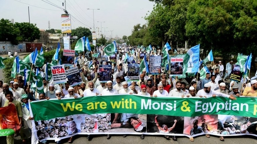 Supporters of Islamic party Jammat-e-Islami march in Karachi on Friday against the Egyptian military crackdown. Hundreds rallied across Pakistan on Friday in support of the ousted Egyptian president Mohamed Morsi and to condemn the use of force against the Muslim Brotherhood, witnesses said.