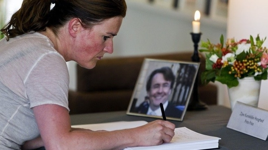 A woman signs the condolence book for Prince Johan Friso in the town hall of Baarn on August 13, 2013. Dutch prince Friso, who excluded himself from the line of succession in the name of love, was to be buried on Friday after he died from injuries sustained in a 2012 skiing accident.