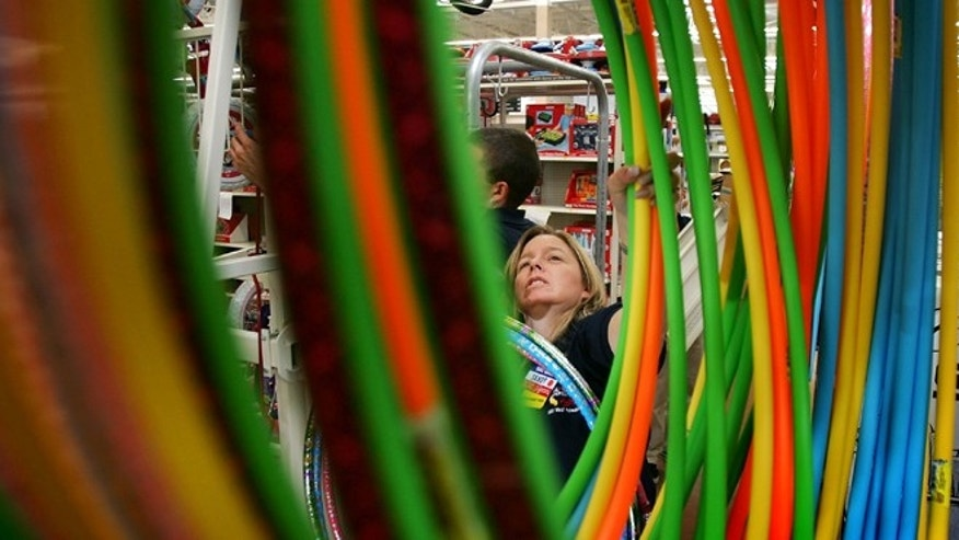 PALMDALE, CA - AUGUST 18:  Wal-Mart employee Sandy Johnson stocks merchandise at the soon-to-be-opened Wal-Mart Palmdale Supercenter department store on August 18, 2005 in Palmdale, California. The new 205,000-square-foot store employing 735 people will be open 24 hours a day when it opens to the public. Other Supercenter stores in California are in modest-sized cities such as La Quinta, Hemet, Stockton, and Calexico.  (Photo by David McNew/Getty Images)