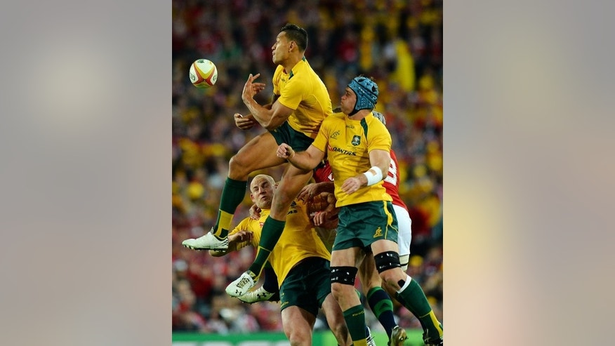 Australia's Israel Folau (top) tries to catch the ball during the third and final Test against the British and Irish Lions in Sydney on July 6, 2013. The Wallabies plan to get more of the ball to Israel Folau in a bid to defeat the All Blacks in Saturday's Bledisloe Cup Test.