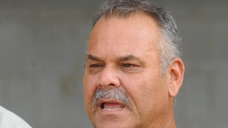 Pakistan's cricket coach Dav Whatmore talks to media representatives during a practice session at the Gaddafi Cricket stadium in Lahore on May 16, 2012. Whatmore Friday warned his team against being complacent when they face up to lowly Zimbabwe next week in a tour considered important for blooding new players.