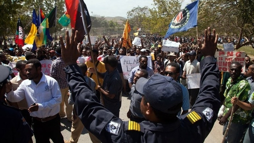 Hundreds of students march towards the university gate in Port Moresby, Papua New Guinea on August 2, 2013, angry at plans to take Australia's asylum-seeking refugees.