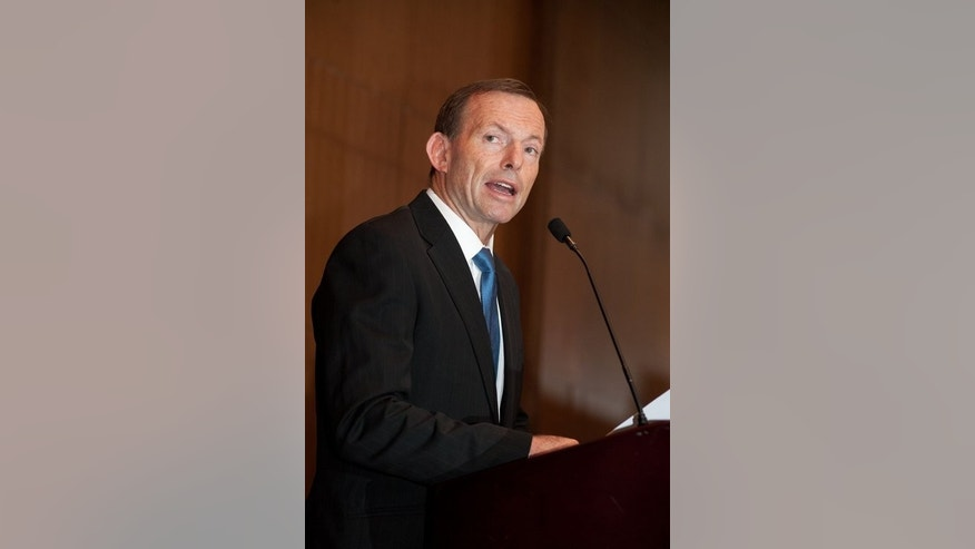 Australian opposition leader Tony Abbott delivers a speech on July 24, 2012. He has pledged his own crackdown on asylum seekers if his conservative opposition party wins September's election.