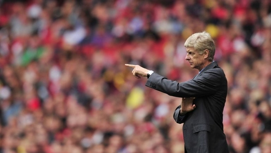 Arsenal's French manager Arsene Wenger gestures during the English Premier League football match between Arsenal and Aston Villa at the Emirates stadium in North London on August 17, 2013. Villa's 3-1 win prompted an angry reaction among supports who demanded Arsenal invest more heavily in transfers.