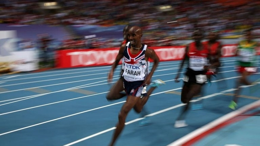 Great Britain's Mo Farah competes during the men's 5000 metres final at the 2013 IAAF World Championships at the Luzhniki stadium in Moscow on August 16, 2013.