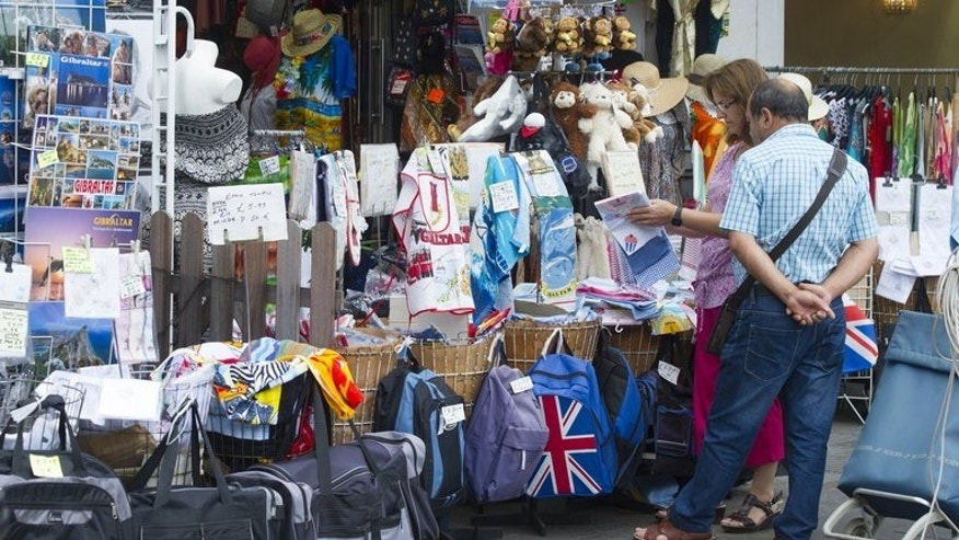 Tourists shop in Casemates square in Gibraltar on August 13, 2013. The self-governing British overseas territory, measuring just 6.8 square kilometres (2.6 square miles), is home to about 30,000 people, and overlooks the only entrance to the Mediterranean from the Atlantic Ocean.