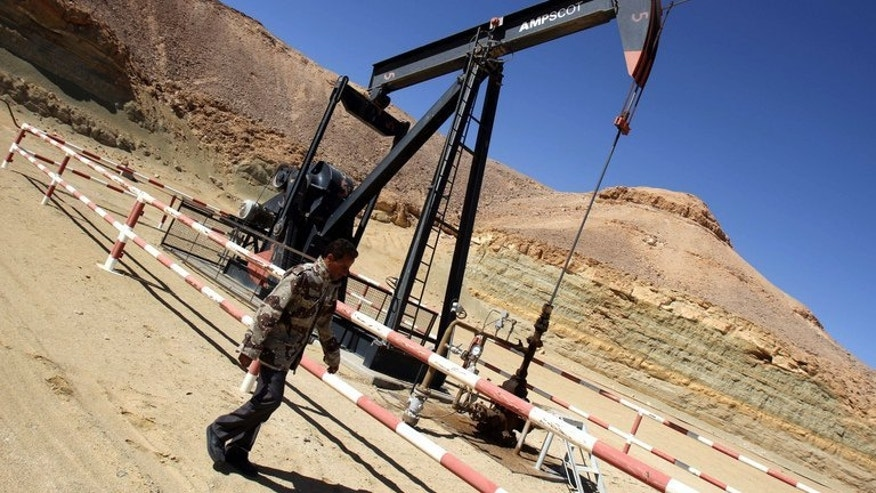An oil drill at the al-Ghani oil field, belonging to Libya's Harouge Oil. Libya is threatening to use military force to bring order to its oil sector, where a strike by guards has dealt a heavy blow to its fragile post-revolution economy.