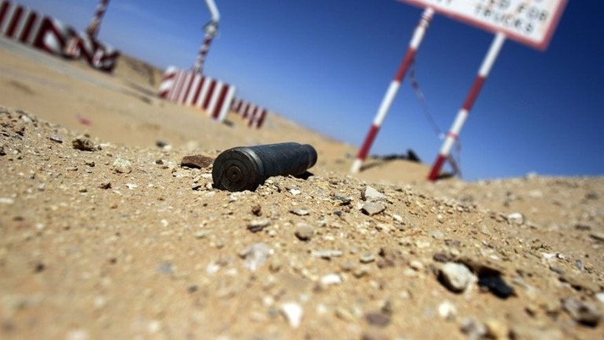 An empty bullet shell at the entrance of the al-Ghani oil field, belonging to Libya's Harouge Oil. Oil exports plunged by more than 70 percent at the end of July after guards, including rebels who helped topple dictator Moamer Kadhafi two years ago, forced terminals to shut.