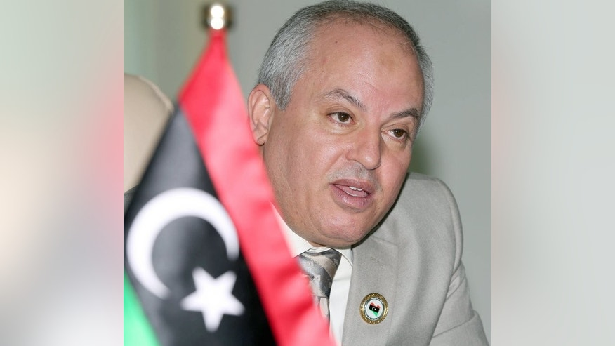 Libyan Minister of Oil and Gas Abdelbari al-Arussi at an interview with AFP in Tripoli on March 13. Armed guards in charge of protecting Libya's vital oil industry were formed by the defence ministry after the fall of Kadhafi, and include rebels who helped topple him.
