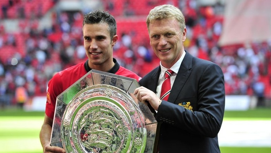 David Moyes (right) and Man Utd striker Robin Van Persie with the Community Shield at Wembley on August 11. The opening day of the 2013-14 Premier League season dawned on Saturday with David Moyes admitting he is still adjusting to the novelty of being Manchester United's new manager.