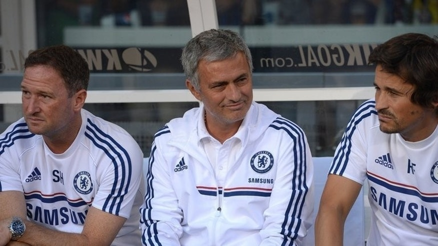 Chelsea's coach Jose Mourinho (C) during a 2013 International Champions Cup match on August 4, 2013. He returned to Chelsea after a six-year absence -- one of five managerial changes in the league.