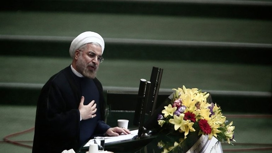 Iranian President Hassan Rowhani speaks during a parliament session to elect cabinet members on August 15, 2013 in Tehran. Rowhani called Saturday for a foreign policy free of damaging sloganeering as Foreign Minister Mohammad Javad Zarif took office.