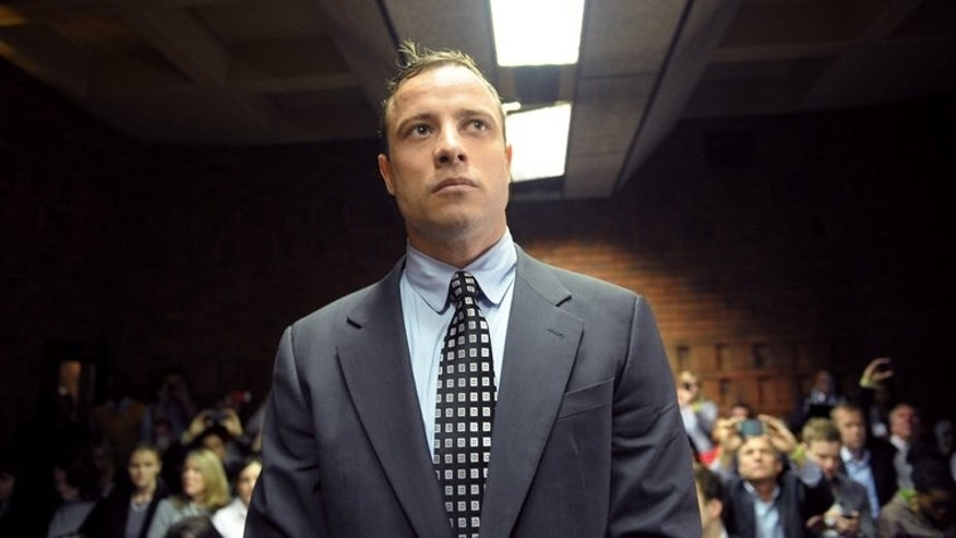 A file picture taken on June 4, 2013 shows South African Paralympic sprinter Oscar Pistorius appearing at the Magistrate Court in Pretoria. Pistorius will go on trial in March next year on murder charges for shooting his girlfriend, his lawyer said Saturday.
