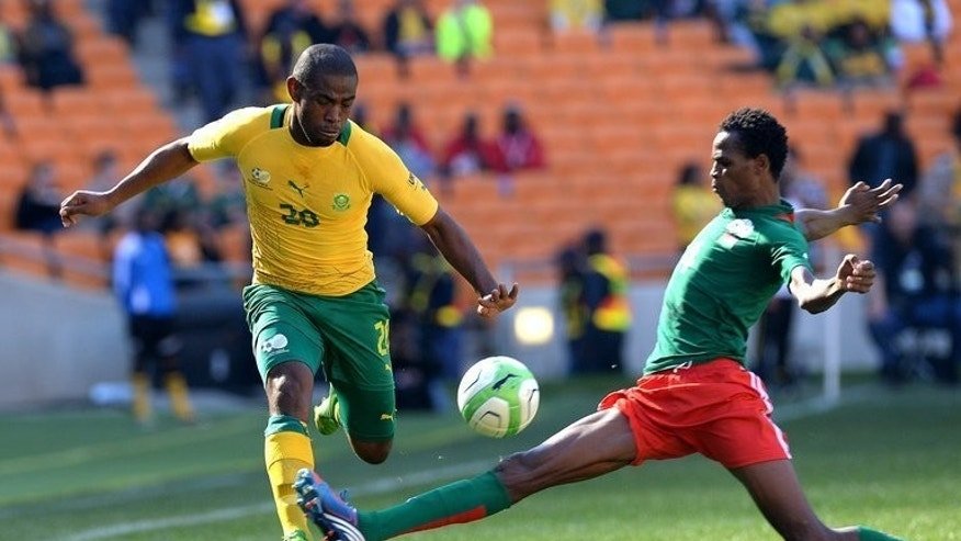 Bafana Bafana's Luyolo Nomandela (L) plays during the Nelson Mandela Sports and Culture Day in Soweto at FNB Stadium on August 17, 2013.