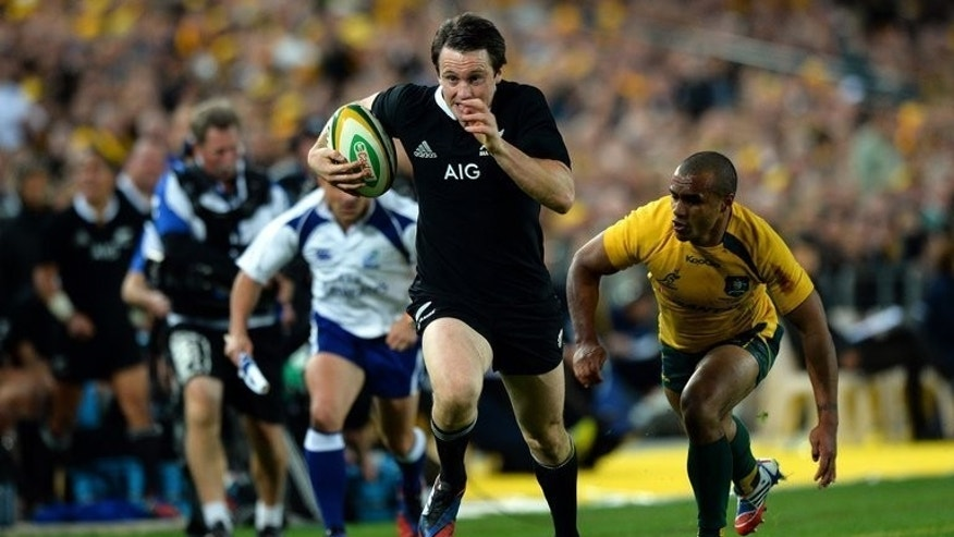Ben Smith (centre) runs for a try after evading Australia's Will Genia in Sydney on Saturday. The All Blacks scored six tries to crush the Wallabies 47-29 in the opening Rugby Championship Test in Sydney on Saturday.