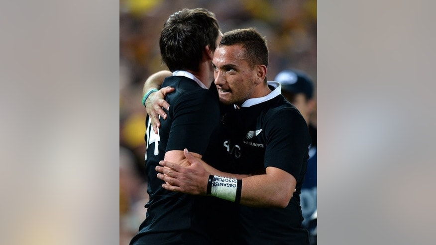 Aaron Cruden (right) celebrates with Ben Smith after New Zealand crush Australia 47-29 on Saturday. Cruden, who had a fine match, finished with 20 points from his try, three conversions and three penalties.