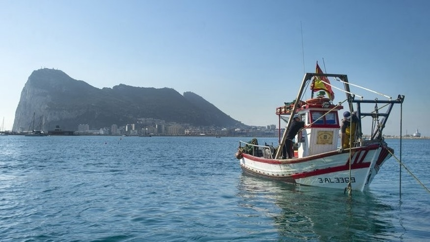 Men from La Linea de La Concepcion fish on Friday in the area where Gibraltar dropped concrete blocks. Spanish fishermen say their catch has been ruined by Gibraltar's decision to drop concrete blocks in waters surrounding the tiny British outpost.
