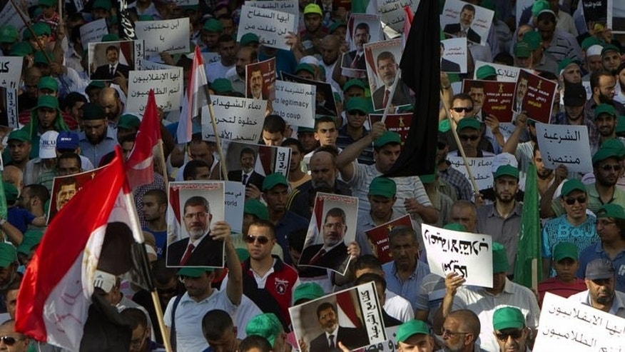 Members of the Arab-Israeli Islamic Movement protest in support of deposed Egyptian president Mohamed Morsi (portrait) and against the army crackdown on Muslim Brotherhood supporters, in the northern Israeli city of Nazareth on August 17, 2013.