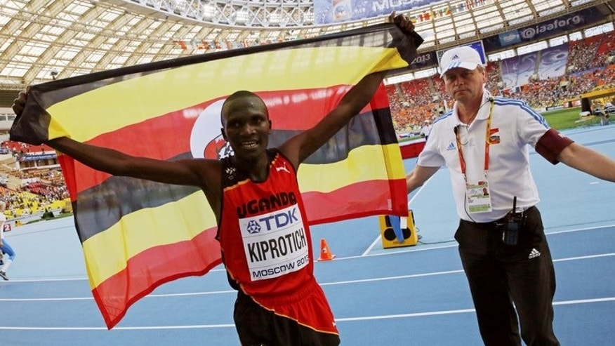 Stephen Kiprotich celebrates winning the World Championship marathon in Moscow on Saturday. Kiprotich added the world marathon gold to his Olympic title, again shutting out strong Ethiopian and Kenyan squads.