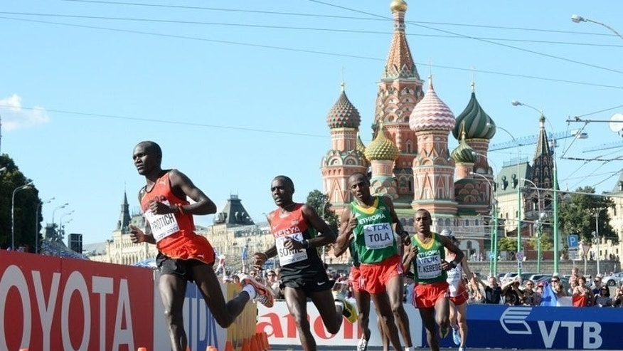 Stephen Kiprotich leads the marathon runners through Moscow's Red Square Saturday. Uganda's Olympic champion went on to win the men's marathon title at the World Athletics Championships.