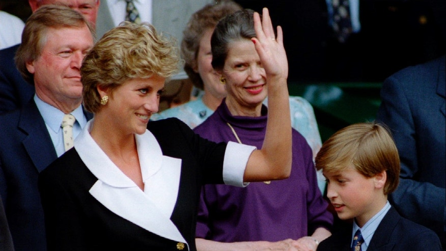 July 2, 1994: Diana, Princess of Wales, accompanied by her son Prince William (R), is seen arriving at Wimbledon's Centre Court before the start of the Women's Singles final in London in this file photograph.