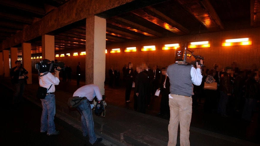 Oct. 8, 2007: Media film the jury from the Coroner's inquest into the deaths of Diana, Princess of Wales and Dodi al-Fayed as they enter the Pont de l'Alma tunnel in Paris where the Mercedes the couple were traveling in crashed.