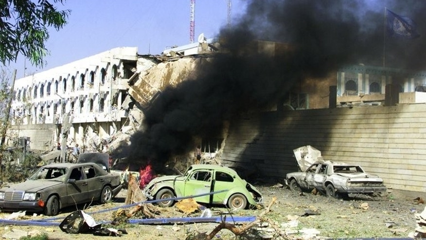 "File photo dated August 19, 2003, shows a car burning outside the United Nations headquarters in Baghdad after a huge explosion rocked the building. A massive Baghdad bombing a decade ago, termed ""the 9/11 of the UN"", killed 22 people and drove heightened security measures that ultimately limited interactions with ordinary Iraqis."