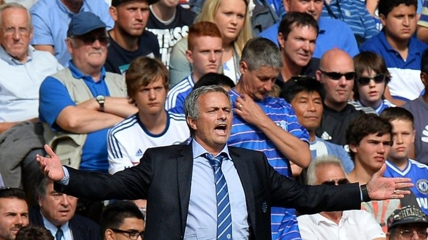 "Jose Mourinho watches Chelsea play Hull City at Stamford Bridge on Sunday. Mourinho captured the mood before his first game back at Chelsea against Hull City by writing in Sunday's match-day programme: ""It's great to write again to my Blues brothers."""
