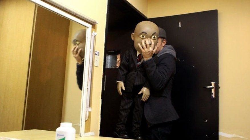 Comedian Conrad Koch takes his puppet Chester Missing from his dressing room to the stage at the Market Theatre in Johannesburg on May 7, 2013.