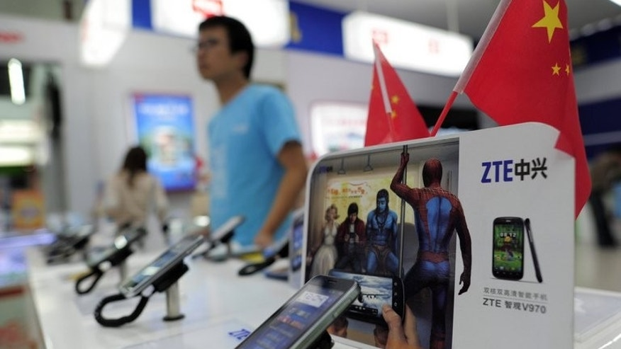 Mobile devices are displayed on a ZTE sales counter in Wuhan, central China's Hubei province on October 8, 2012. Ethiopia signed an $800-million (600-million-euro) agreement with Chinese telecom giant ZTE Sunday to expand its telecommunications network, national operator Ethio Telecom said.