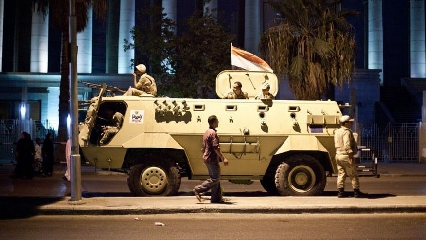 An Egyptian army armoured vehicle in front of the Supreme Constitutional Court in Cairo on August 18, 2013. German chancellor Angela Merkel said on Sunday that stopping arms shipments to Egypt would be an appropriate way to put pressure on the country as it is gripped by deadly violence.