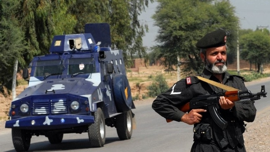 A member of Pakistan's Frontier Corps (FC) stands guard at the blocked off Indus Highway in the Spina Thana area near Darra Adam Khel on September 27, 2008. Two gunmen on a motorcycle opened fire Sunday on a checkpoint of the paramilitary Frontier Corps in Pakistan's troubled southwest, killing one soldier and wounding two others, officials said.