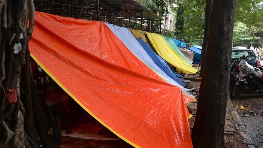 Temporary shelters house cancer sufferers seeking treatment at the Tata Memorial Hospital in Mumbai on August 1, 2013. Many cannot afford hotels and are forced to sleep on the street.