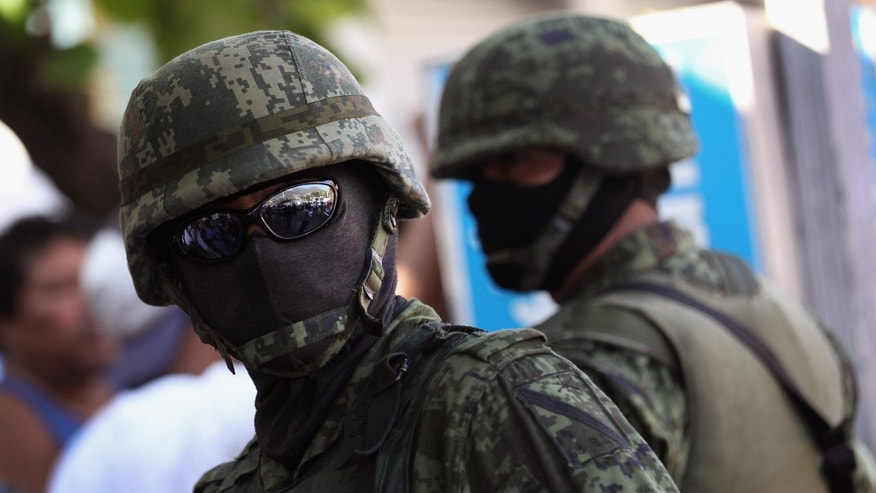 ACAPULCO, MEXICO - FEBRUARY 29:  Mexican army soldiers stand guard at the site of a suspected drug execution on February 29, 2012 in Acapulco, Mexico. Drug violence surged in the coastal resort last year, making Acapulco the second most deadly city in Mexico after Juarez. One of the country's top tourist destinations, Acapulco has suffered a drop in business, especially from foreign tourists. Toursim accounts for some 9 percent of Mexico's economy and about 70 percent of the output of Acapulco's state of Guerrero.  (Photo by John Moore/Getty Images)