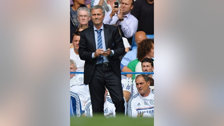 Chelsea's Portuguese manager Jose Mourinho looks on during the English Premier League football match between Chelsea and Hull City at Stamford Bridge in London on August 18, 2013.