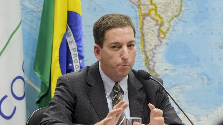 "Handout picture released by the Brazilian Senate showing Brazil-based Guardian reporter Glenn Greenwald in Brasilia, on August 6, 2013. Rights group Amnesty International on Sunday accused British authorities of ""unwarranted revenge tactics"" after the partner of a journalist responsible for publishing US surveillance revelations was detained for nine hours."
