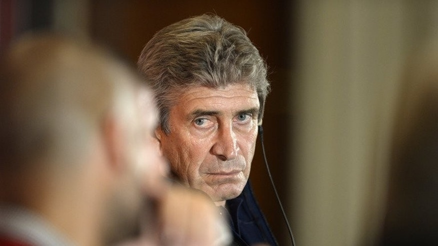 Manchester City coach Manuel Pellegrini at a press conference on July 30, 2013. He admits he will need all his striking options if the team are to bag trophies this year.